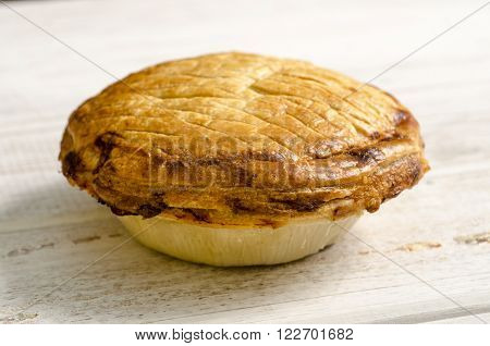 Whole Puff Pastry Pie On White Wooden Background