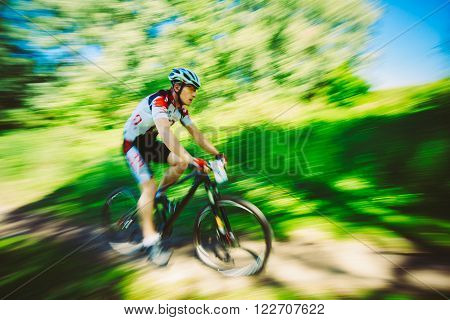Mountain Bike cyclist riding track at sunny day, healthy lifestyle active athlete doing sport