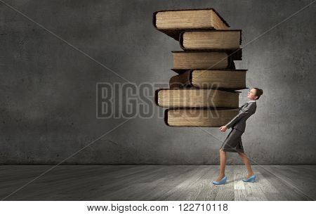 Woman carrying stack of books