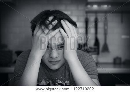 Sad teenage boy. Black and white photo