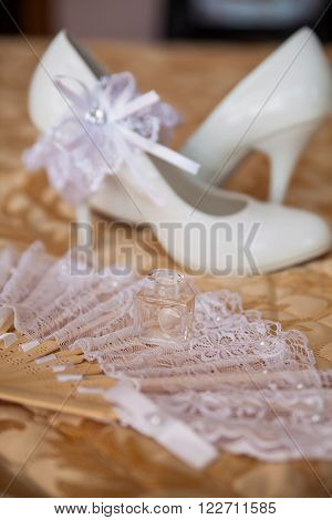 beautiful white shoes and bride's wedding accessories