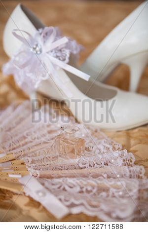 beautiful white shoes and bride's accessories for wedding