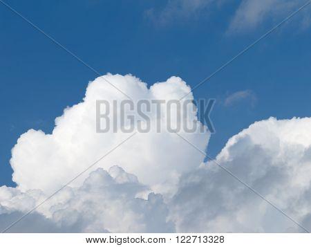 nice big fluffy white cumulus clouds against a bright blue sky