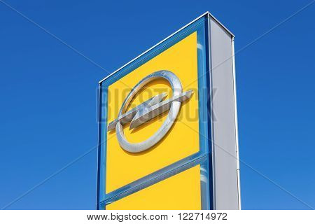 SAMARA RUSSIA - MARCH 20 2016: Opel dealership sign against blue sky. Opel is a German automobile manufacturer