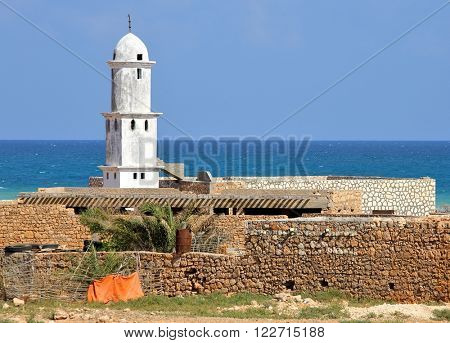 Mosque on Socotra island (Yemen) with turquoise sea background