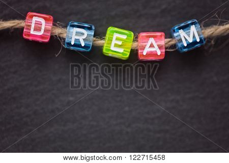 DREAM word concept top view  made of small colorful letters