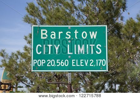 Green and white Barstow city limits sign