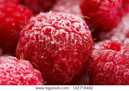 Close up view on frozen Raspberry fruits food background Raspberry