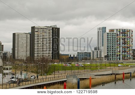 LONDON UK - MARCH 19 2016: Old blocks of flats forming the Carpenters Estate on the left with modern blocks of flats on the right viewed from Queen Elizabeth Park in Stratford London. The old flats are threatened with demolition.