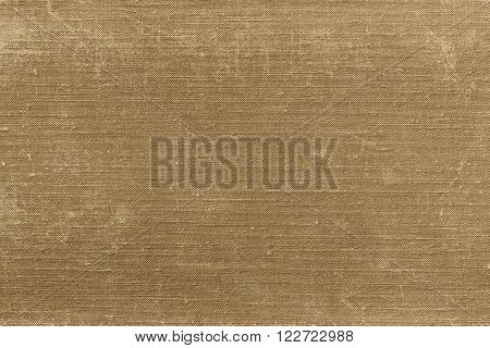 rough texture of old material from cotton or from a sackcloth for a textile background or for wallpaper of sepia color with attritions
