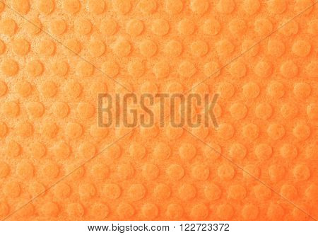 Orange kitchen wipe cloth close-up fragment as a background texture