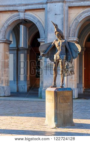 Statue of bird-catcher Papageno, character of Mozarts opera The Magic Flute, in front of Stadsschouwburg Theatre in Bruges, Belgium