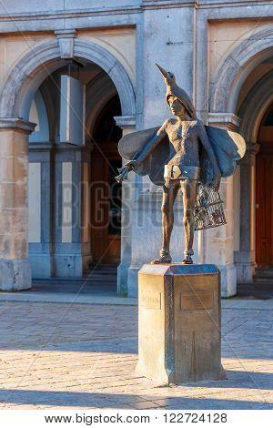 Statue of bird-catcher Papageno, character of Mozarts opera The Magic Flute, in front of Stadsschouwburg Theatre in Bruges, Belgium