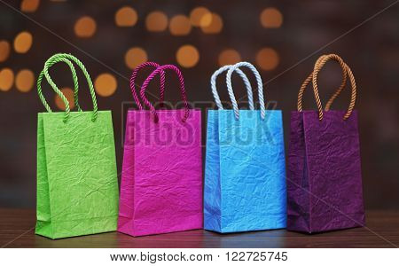 Colored shopping bags on Christmas background