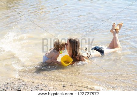 Mother With Child In Water