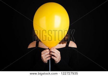 Girl Hiding Her Face Under Yellow Balloon