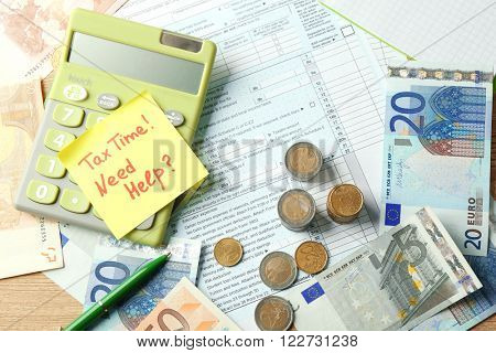 Money concept. Green calculator with cash and documents, close up