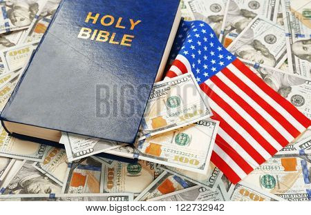Holy Bible with American flag on money background
