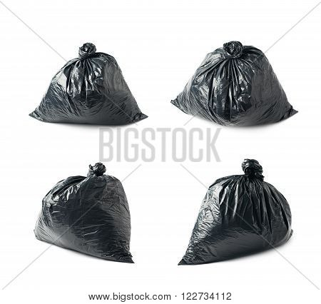Closed and tied in a knot black plastic garbage bag isolated over the white background, set collection of four different foreshortenings