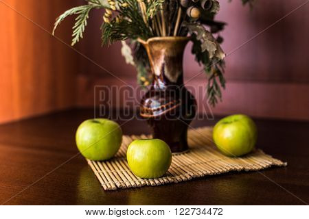Still life vase with spikelets of wheat and apples