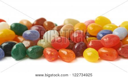Decorational line made of colorful jelly bean candies isolated over the white background