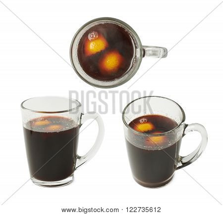 Glass mug filled with mulled wine and orange peels, composition isolated over the white background, set of three different foreshortenings