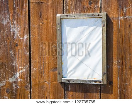 Blank notice-board on wooden background - image with copy space