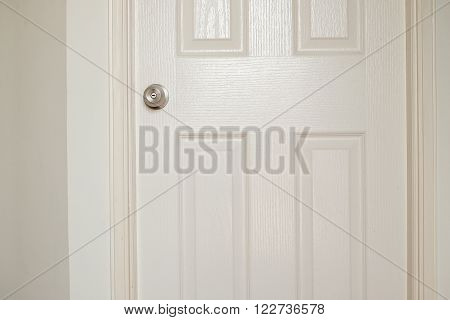 Interior design wooden white door and white wall