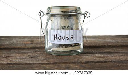 Jar for savings full of banknotes