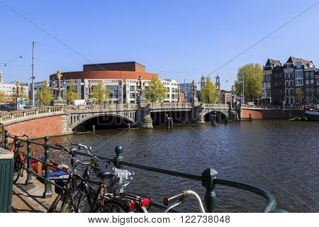 Amsterdam, Netherlands - May 5: The Opera House and the Blue Bridge through river Amstel May 5, 2013 in Amsterdam, Netherlands.