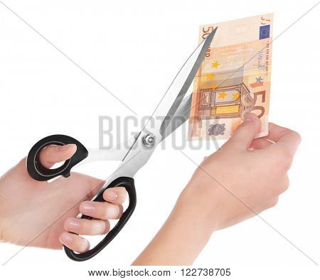 Hands with scissors cutting Euro banknote, isolated on white