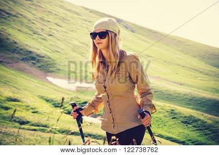 Young Woman hiking Travel Lifestyle concept Summer journey vacations outdoor mountains on background