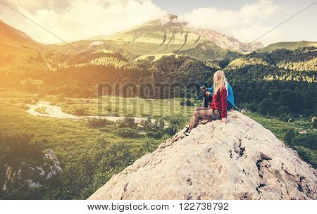 Woman and Man Travelers relaxing on summit hiking Travel Lifestyle concept Summer vacations outdoor aerial view forest mountains on background