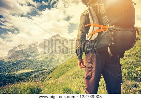 Traveler Man with backpack mountaineering Travel Lifestyle concept mountains on background Summer trip vacations outdoor