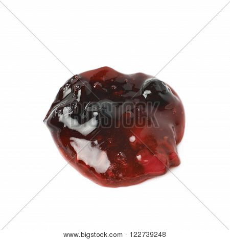 Tiny spill stain puddle of red wild berries jam isolated over the white background