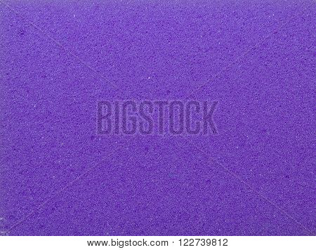 purple porous sponge for cleaning and Drugova, closeup