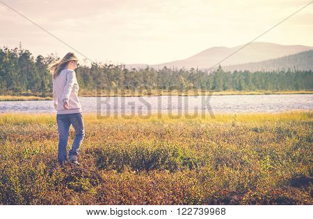 Woman Traveler walking alone Travel Lifestyle concept Summer vacations outdoor tundra forest on background