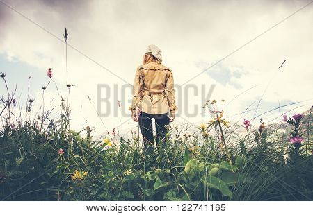 Young Woman walking alone Travel Lifestyle concept Summer vacations outdoor rocky mountains on background view from the ground