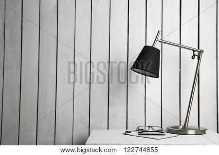 Lamp on the locker on wall background