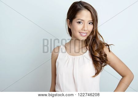 portrait of beautiful young asian woman with flawless skin and perfect make-up