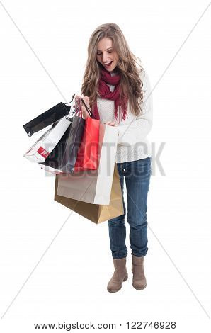 Enthusiastic shoping girl looking at what she bought