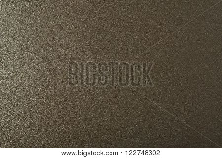 Fragment texture of a metal coated with teflon