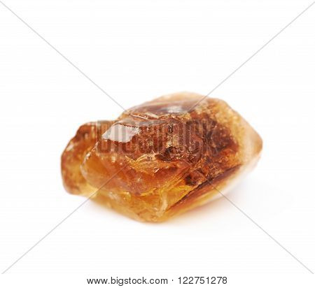Large brown rock sugar crystal isolated over the white background