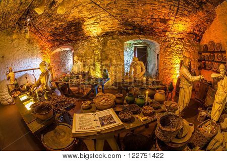 Stirling, Scotland, United Kingdom - May 28, 2015: Representation of an ancient farm scene in historic Stirling Castle. Typical food goods: cereals, meat and vegetables, cooked by medieval peasants.