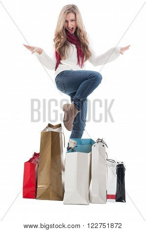 Shopping woman expressing joy and happyness between many shopping bags