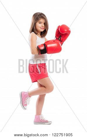 Cute and adorable little boxing girl on white background