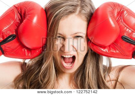 Female Model Wearing Red Boxing Gloves Screaming Or Shouting
