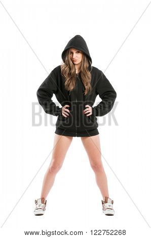 Sexy cute kinky and adorable young woman wearing a black hoodie
