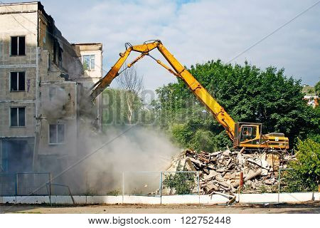 Excavator demolishes the old soviet apartment house in Moscow