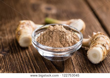 Portion of Galangal Powder (detailed close-up shot; selective focus)